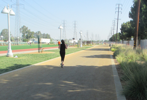 Lone runner on long shady track at Salud Park