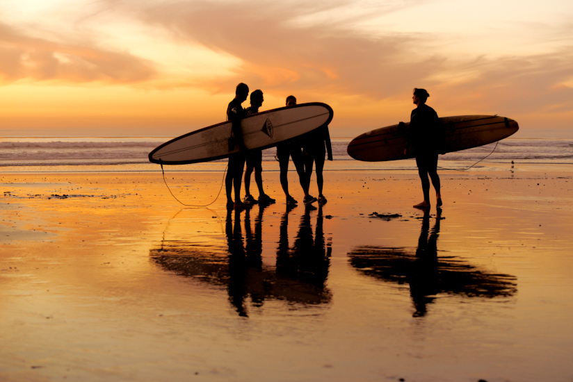 Surfers at state beach in the sunset