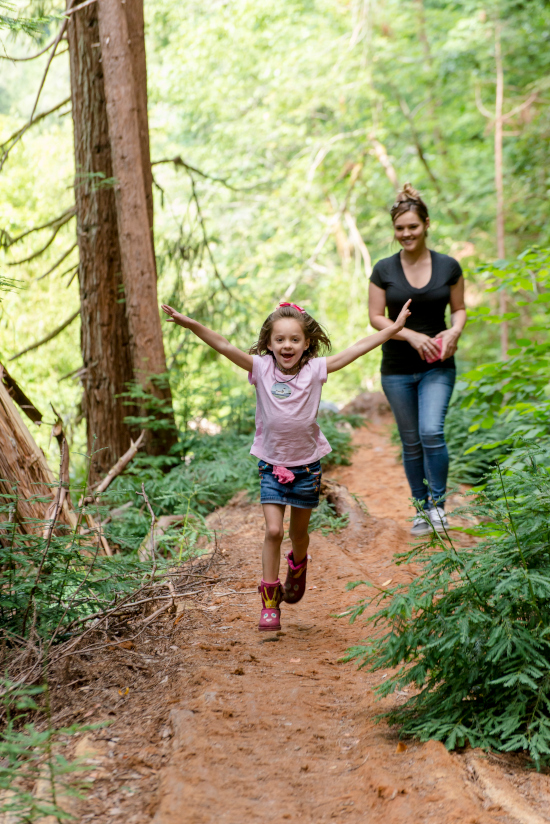 Woman and child on trail in forest